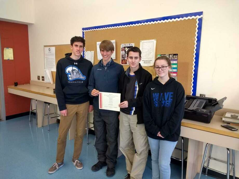 Darien High School's Griffin Ott, from left, Matt Shabet, Dan Pfrommer and Julia Pfrommer put their math skills to the test in an international competition, placing in the the top 20 percent. Photo: Contributed Photo