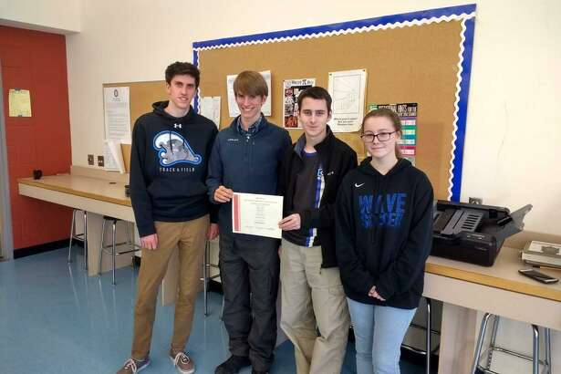 Darien High School's Griffin Ott, from left, Matt Shabet, Dan Pfrommer and Julia Pfrommer put their math skills to the test in an international competition, placing in the the top 20 percent.