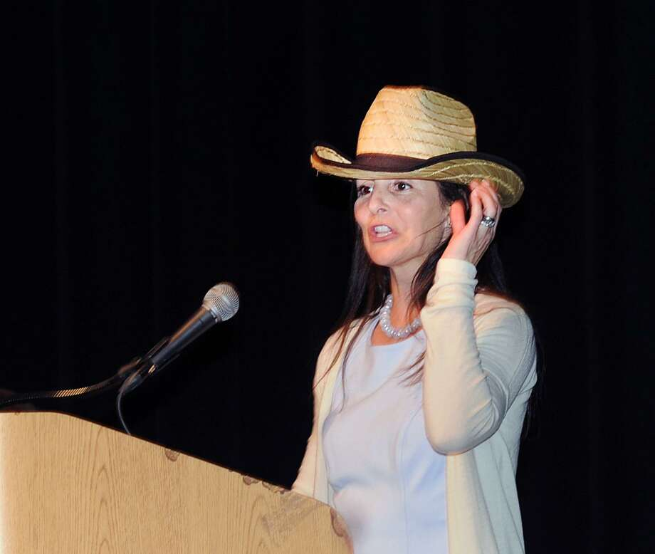 Greenwich Public Schools Distinguished Teacher honoree Victoria Morrison Cappiali, a North Street School Kindergarten teacher, wears a cowgirl hat, one of the many hats of a teacher she said, as she spoke during the awards ceremony at the Greenwich High School Performing Arts Center, Greenwich, Conn., Tuesday, May 2, 2017. Photo: Bob Luckey Jr. / Hearst Connecticut Media / Greenwich Time