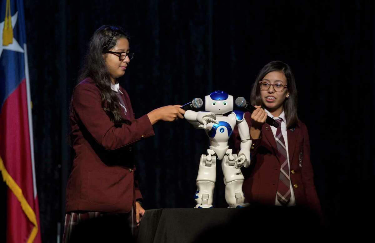 Young Women's College Preparation Academy sophomores Stephany Flores, 16, left, and Lesley Lopez, 15, programmed this robot to dance the