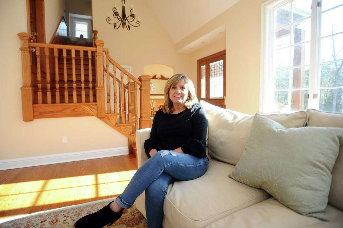 Tammy Cebo poses for a photo inside her on-the-market 4,000-square-foot country French home on High Ridge Road in north Stamford, Conn. on Tuesday, Feb. 13, 2018.