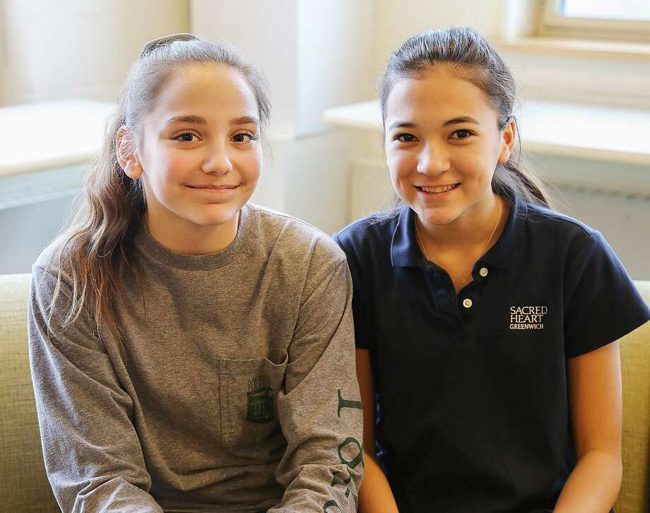 New Canaan's Sophie Broll and India Harris, eighth-graders at Sacred Heart Greenwich, earned gold in a Scholastic writing competition. Photo: Contributed Photo / New Canaan News