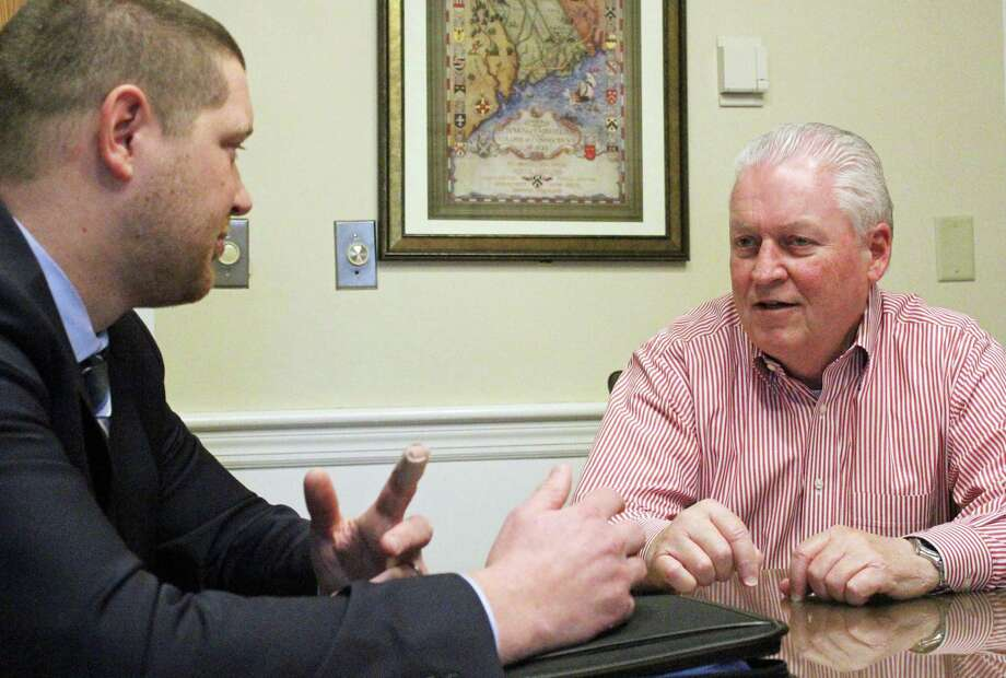 Matthew Fulda, left, executive director of the Connecticut Metropolitan Council of Governments, and First Selectman Mike Tetreau, the group's chairman, discuss getting a special designation that would allow them to get more in federal grant money. Fairfield,CT. 2/14/18 Photo: Genevieve Reilly / Hearst Connecticut Media / Fairfield Citizen