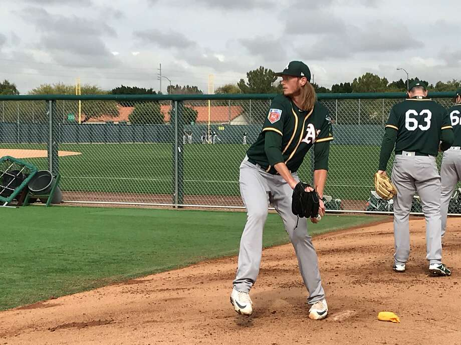 A's top prospect A.J. Puk threw his first official bullpen of the spring Thursday at Fitch Park. Photo: Susan Slusser, The Chronicle