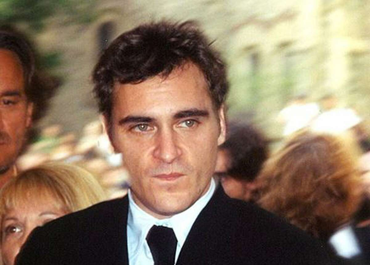 """Joaquin Phoenix is """"in talks"""" to play The Joker in Todd Phillips' origin film. He has been in talks for major comic-book roles before. Photo of Phoenix at the 2005 Toronto Film Festival by Tony Shek."""