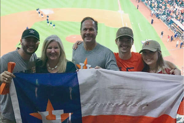 Sports enthusiasts John and Kresha Sivinski and their three kids made a photo at an Astros playoff game part of their Christmas card last year.