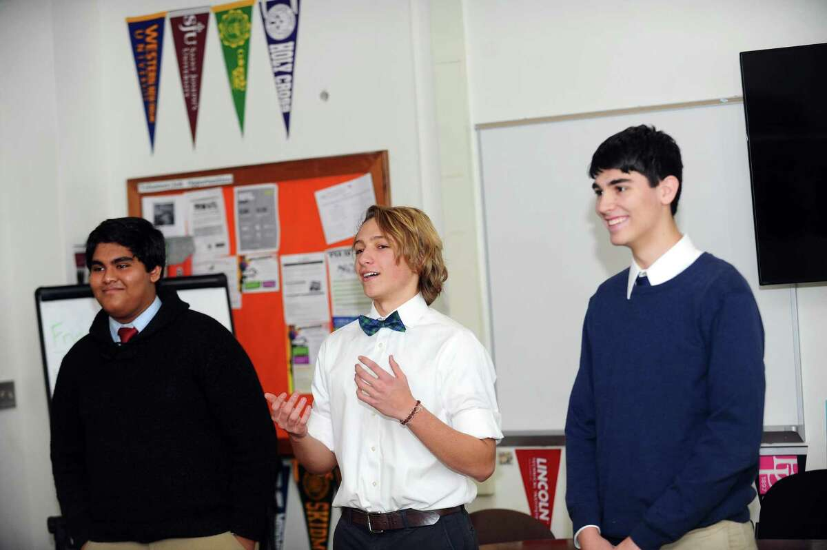 Stamford High seniors, from right, James Pease, Augustus Doricko and Imtiaz Uddin speak about their project inside the College and Career Center at Stamford High School in downtown Stamford, Conn. on Tuesday, Feb. 13, 2018. Stamford High students won a $4,000 grant from the Toshiba America Foundation for 13 students to participate in the Student Spaceflight Experiment Program and will use the money to purchase a bioreactor used to simulate a low gravity environment. Their experiment will launch into space in June and land at the International Space Station.