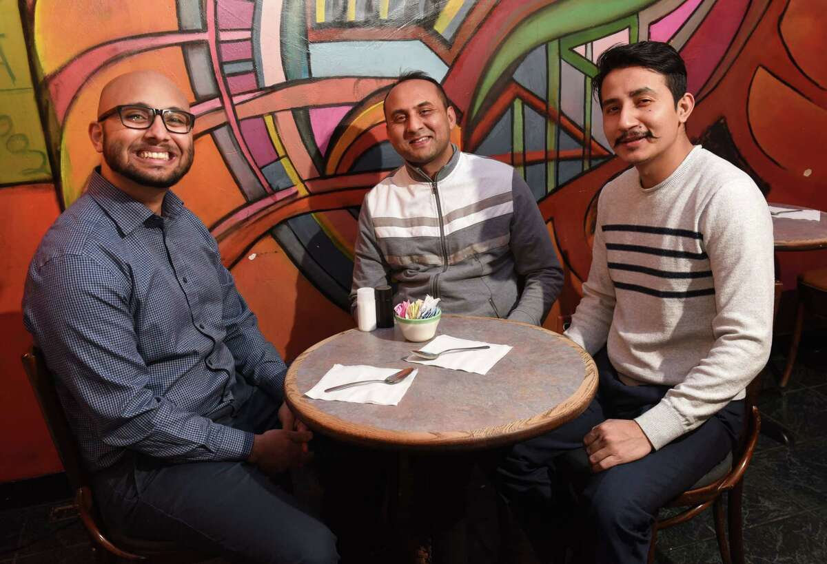 From left, Dilip Pokhrel, Saurav Upadhyay and Saroj Maharjan, organizers of a concert bringing the Nepalese band 1974 A.D. to town next weekend, meet up at Professor Java's on Wednesday Feb. 14, 2018 in Colonie, N.Y. (Lori Van Buren/Times Union)