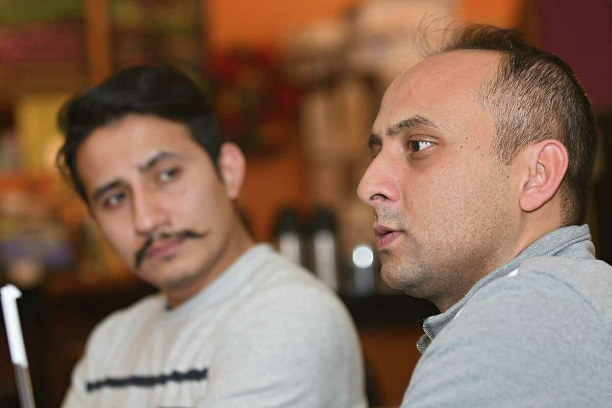 Saroj Maharjan, left, and Saurav Upadhyay, a couple of the organizers of a concert bringing the Nepalese band 1974 A.D. to town next weekend, meet up at Professor Java's on Wednesday Feb. 14, 2018 in Colonie, N.Y. (Lori Van Buren/Times Union)