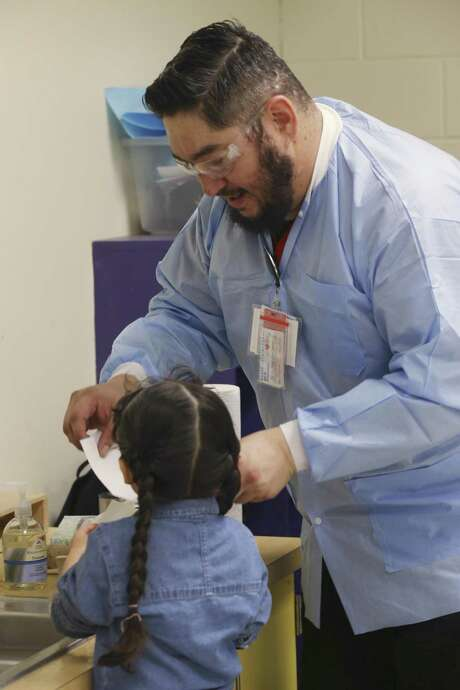 University of the Incarnate Word senior nursing student, Pablo Gutierrez, 37, helps a student with hand washing at the Kate Schenck Elementary School Head Start Program, Thursday, Feb. 15, 2018. The Head Start students were tested for lead exposure. UIW's nursing school has secured a five-year contract with San Antonio's Head Start program to screen its students for high levels of lead. Photo: JERRY LARA / San Antonio Express-News / © 2018 San Antonio Express-News