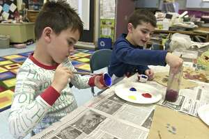 Maddox Colorusso, left, and Lane Bell, both in kindergarten, work on their art projects at Hill & Plain Elementary School. Thursday, December 21, 2017, in New Milford, Conn.
