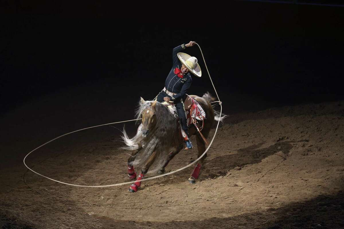 """Charro performer Tomas Garcilazo and his horse, """"Hollywood,"""" entertain the crowd at the 2018 San Antonio Stock Show & Rodeo."""