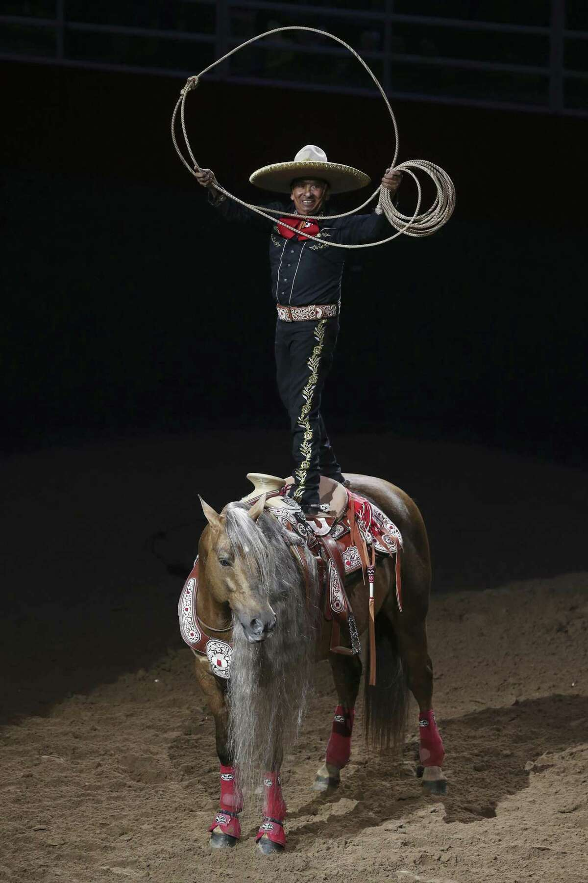 """Charro performer Tomas Garcilazo and his horse, """"Hollywood,"""" entertain the crowd at the San Antonio Stock Show and Rodeo, Wednesday, Feb. 14, 2018."""