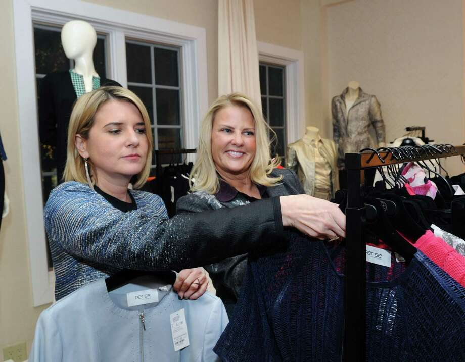 Carlisle Collection Director of the New York City & Greenwich stores, Katie Dougherty, left, with Carlisle stylist Noelle Ward, inventory clothing inside the fashion for women by appointment store in Greenwich, Conn., Wednesday, Feb. 7, 2018. Carlisle Collection with the help of stylist Ward, donates clothing to women in the YWCA of Greenwich Domestic Abuse Services progam. Ward is also a volunteer for the YWCA of Greenwich Domestic Abuse Services program. Photo: Bob Luckey Jr. / Hearst Connecticut Media / Greenwich Time