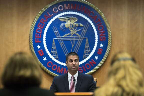 FILE -- Ajit Pai, chairman of the FCC, delivers remarks before the start of a vote on Net Neutrality inside the FCC headquarters in Washington, Dec. 14, 2017. The top internal investigator for the FCC opened an investigation in late 2017 into whether Pai improperly pushed and timed changes to regulations to benefit Sinclair Broadcasting, the large television company. (Tom Brenner/ The New York Times)