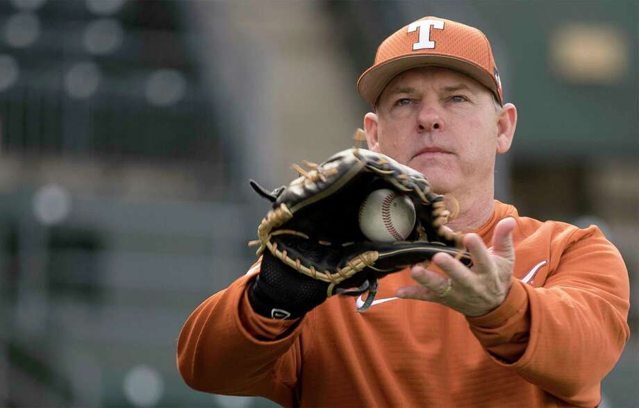 Texas head baseball coach David Pierce warms up during the first practice of the baseball season at UFCU Disch-Falk Field in Austin on Friday, January 27, 2017. Photo: Richard B. Brazziell, PHOTOJOURNALIST