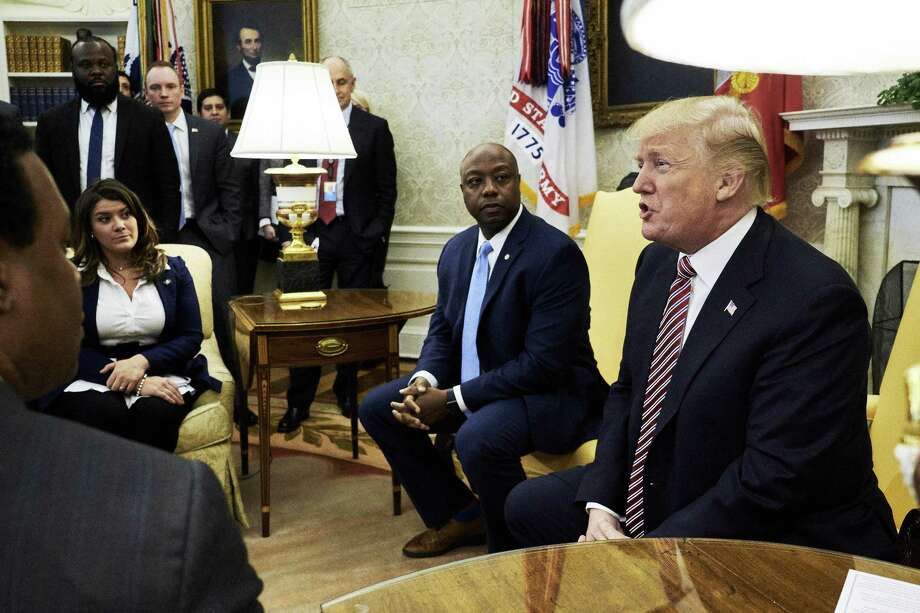 New Britain Mayor Erin Stewart, seen here left, listens as U.S. President Donald Trump, right, speaks during a working session regarding the Opportunity Zones provided by tax reform in the Oval Office of the White House in Washington, D.C., U.S., on Wednesday, Feb. 14, 2018. Photo: T.J. Kirkpatrick / Bloomberg / © 2018 Bloomberg Finance LP