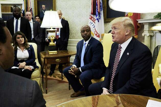 New Britain Mayor Erin Stewart, seen here left, listens as U.S. President Donald Trump, right, speaks during a working session regarding the Opportunity Zones provided by tax reform in the Oval Office of the White House in Washington, D.C., U.S., on Wednesday, Feb. 14, 2018.