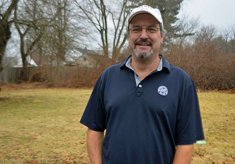 Anthony Pioppi, 55, shown at home in Middletown, has written five books about golf. Photo: Cassandra Day / Hearst Connecticut Media