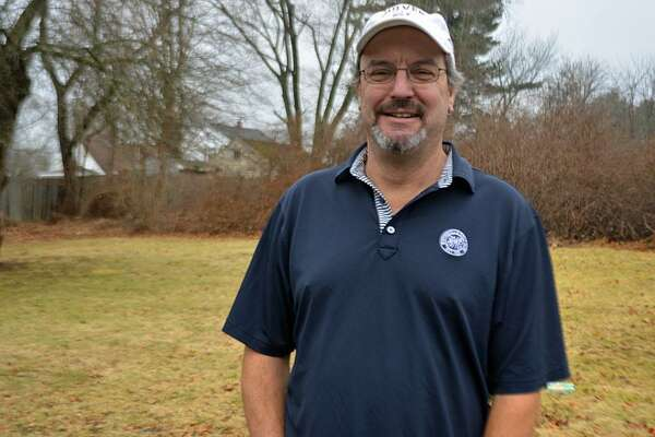 Anthony Pioppi, 55, shown at home in Middletown, has written five books about golf.