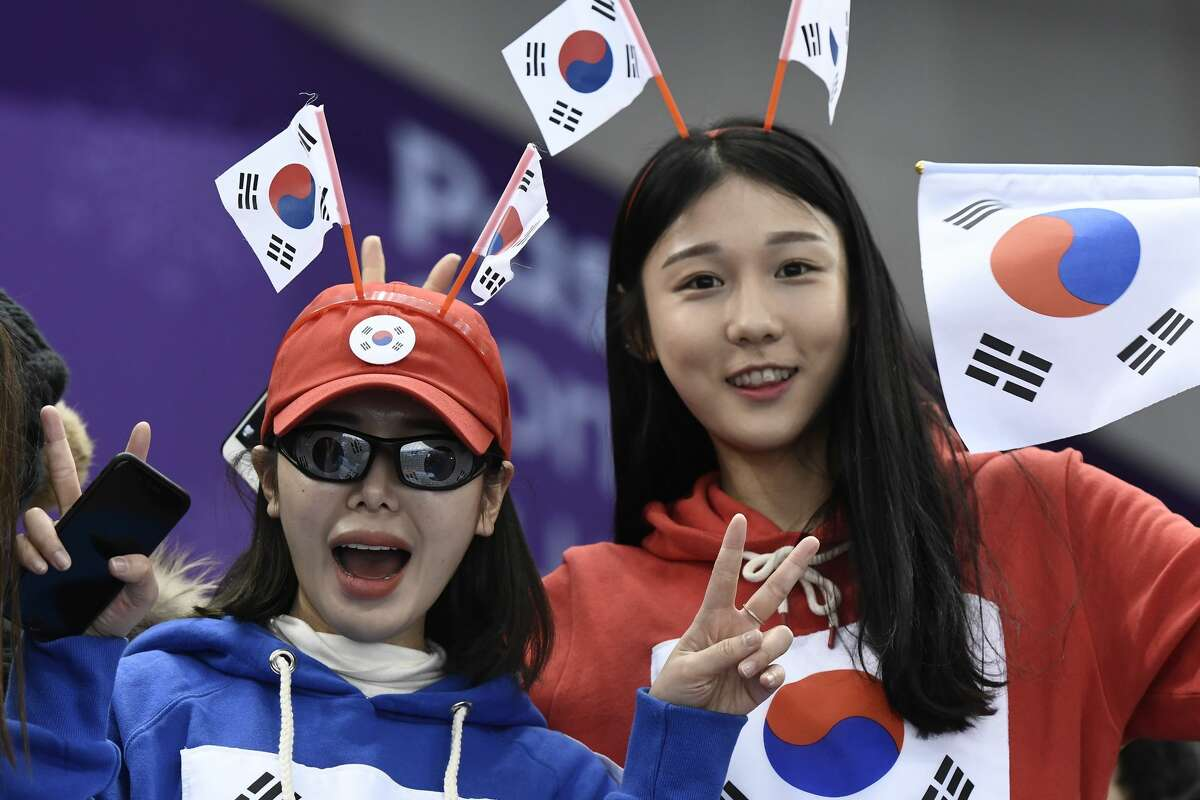South Korea fans cheer on their team during the short track speed skating events during the Pyeongchang 2018 Winter Olympic Games, at the Gangneung Ice Arena in Gangneung on February 10, 2018.