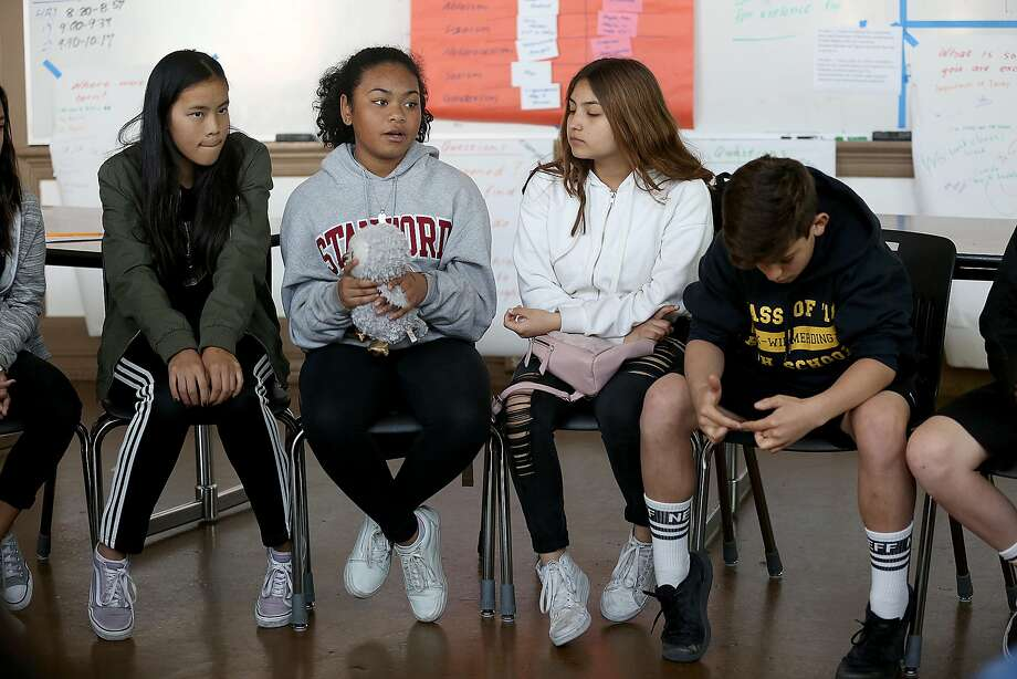 Left to right--Seventh graders Hannah Kositsky  Maya (talking holding owl), Pamela Altamirano, and Joe Dolce in a peer resources class at Everett Middle School talk about the high school shooting on Thursday, February 15, 2018, in San Francisco, Ca. Photo: Liz Hafalia, The Chronicle