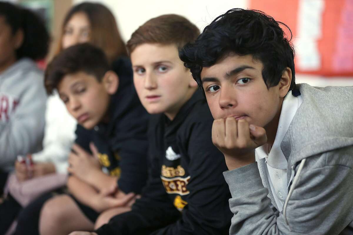 Left to right--Seventh graders Pamela Altamirano, Joe Dolce, Avi, and Michael Marin, in a peer resources class at Everett Middle School as they listen and talk about the Florida high school shooting on Thursday, February 15, 2018, in San Francisco, Ca.