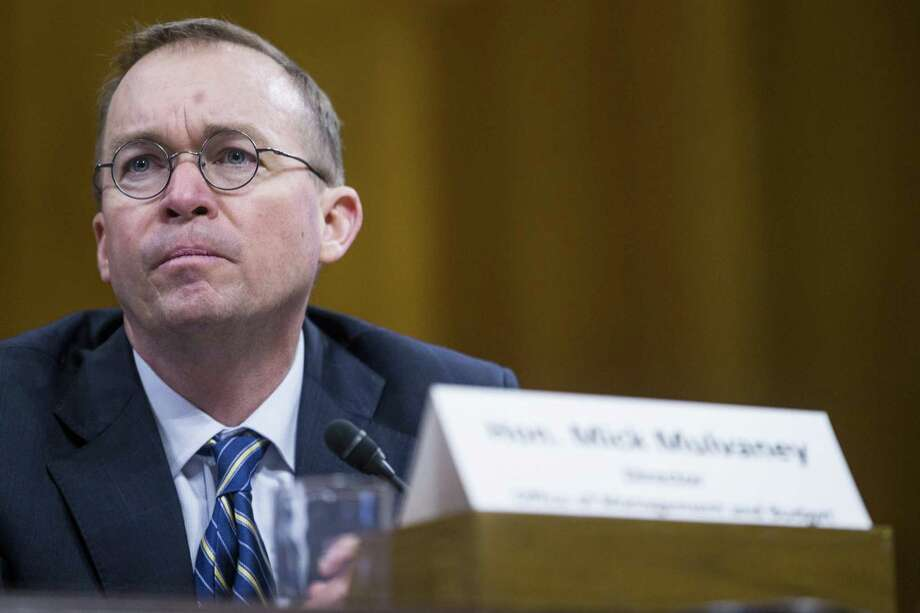 Mick Mulvaney, director of the Office of Management and Budget, listens during a Senate Budget Committee hearing in Washington, D.C., U.S., on Tuesday. Mulvaney discussed the $4.4 trillion federal budget plan that would slash entitlements and other domestic programs in favor of higher spending on the military and immigration enforcement. Photo: Zach Gibson /Bloomberg / © 2018 Bloomberg Finance LP