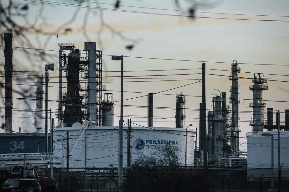 The Philadelphia Energy Solutions LLC refinery stands at sunset in Philadelphia Jan. 26. The bankruptcy of Philadelphia Energy, the biggest refiner on the East Coast, has invigorated efforts to overhaul a 13-year-old federal program promoting biofuels that has drawn bitter criticism from the oil industry. Photo: Michelle Gustafson /Bloomberg / © 2018 Bloomberg Finance LP