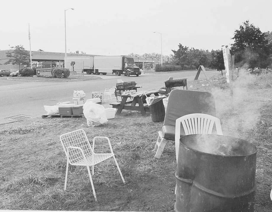 A toxic brew of contaminants from plastic, wood and metal is released from a now-banned burn barrel. Campfires, cooking fires and celebratory bonfires are among fires excluded from the ban. Photo: PAUL D. KNISKERN, SR. / ALBANY TIMES UNION