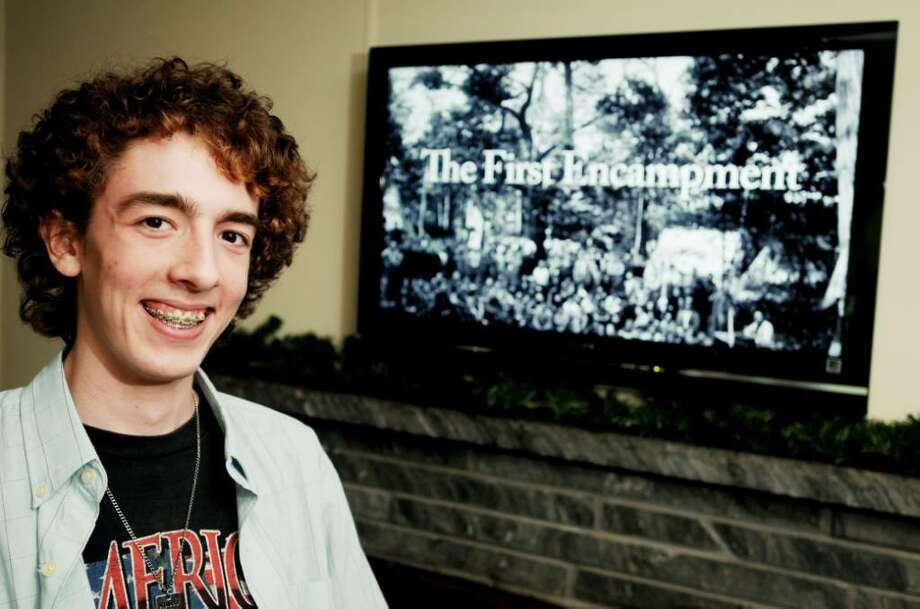 "Blake Cortright, 16, an Eagle Scout since he was 14, is the producer, director and creator of  ""The First Encampment,"" a documentary about  the first Boy Scout camp in America. The opening title shot is on the screen behind Cortright in his Latham home. To celebrate the 100th anniversary of Boy Scouting, WMHT is airing the documentary at 4 p.m. May 29. (Luanne M. Ferris / Times Union) Photo: LUANNE M. FERRIS"