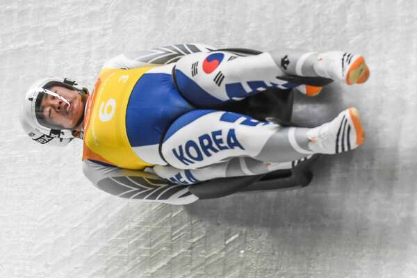 Cho Jung Myung and Park Jinyong of South Korea competing in luge Team Relay Competition at Olympic Sliding Centre at Pyeongchang  , South Korea on February 15, 2018.