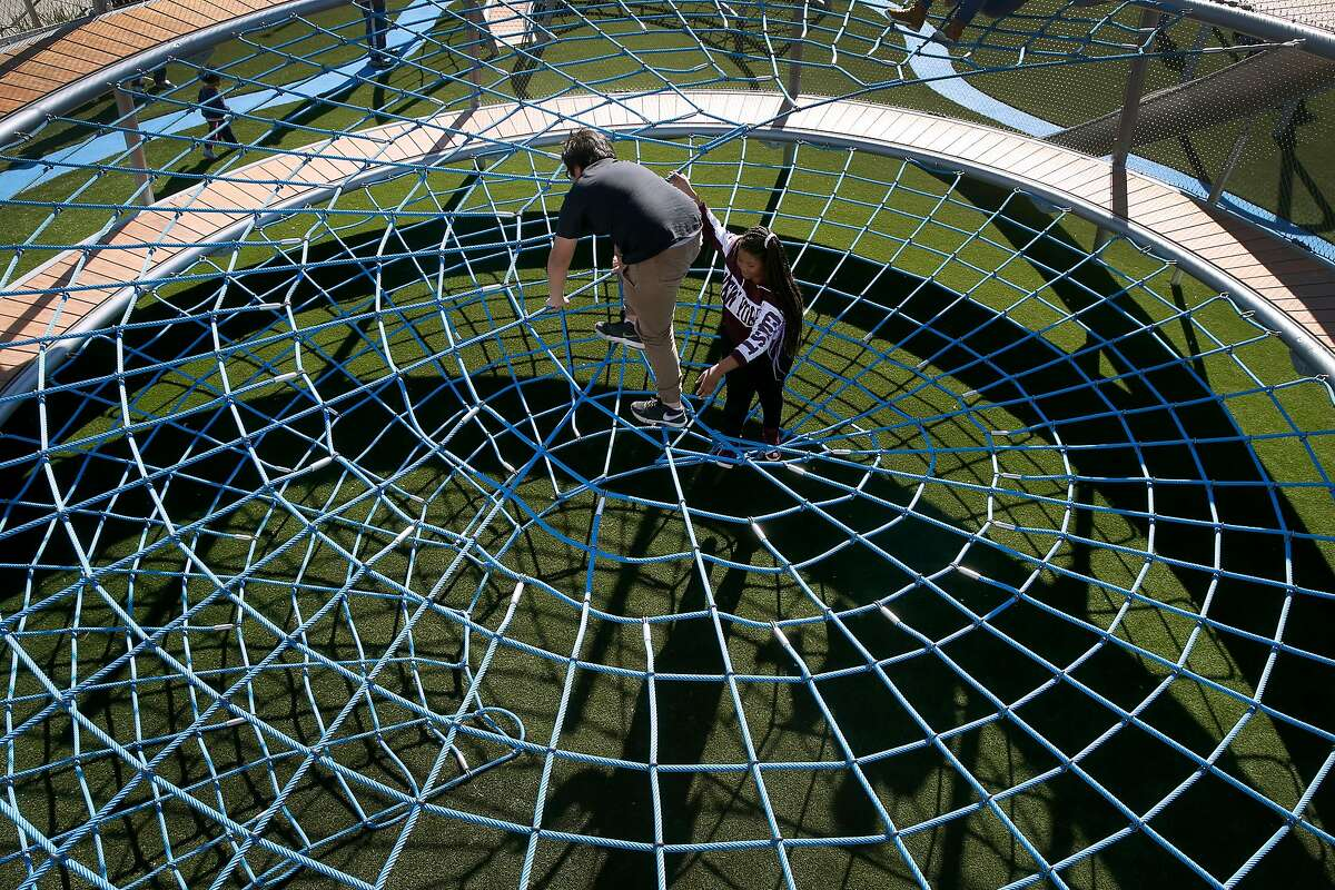 Seventh graders from Martin Luther King Jr. Middle School climb a rope structure at the Helen Diller Civic Center Playground in San Francisco, Calif. on Thursday, Feb. 15, 2018. The 20-year-old playground reopened Wednesday evening after undergoing a $10 million renovation.