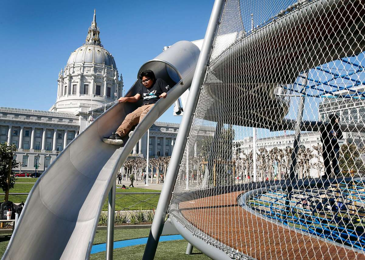 A youngster descends down a slide at the Helen Diller Civic Center Playground in San Francisco, Calif. on Thursday, Feb. 15, 2018. The 20-year-old playground reopened Wednesday evening after undergoing a $10 million renovation.