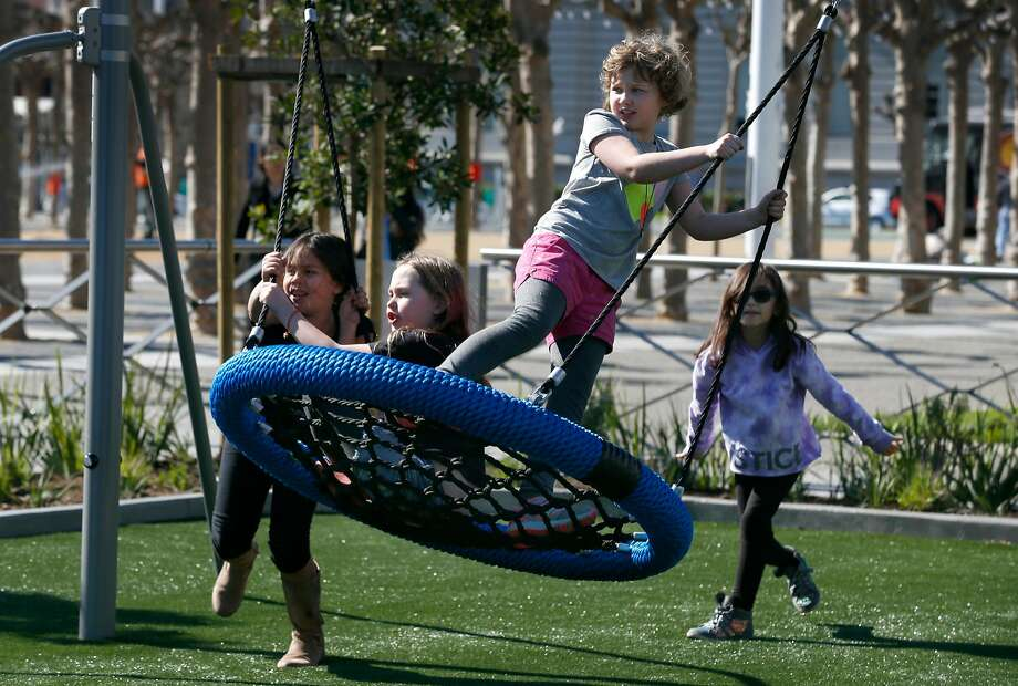 Students from the Marin Preparatory School in the Castro district explore the new Helen Diller Civic Center Playgrounds after touring City Hall in San Francisco. Photo: Paul Chinn, The Chronicle