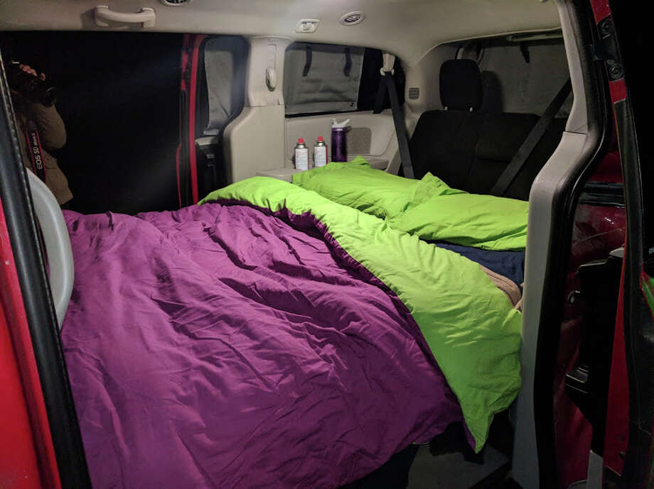 Jucy is committed to the green and purple aesthetic. Even the bedding matches the van. Photo: Alix Martichoux / SFGATE