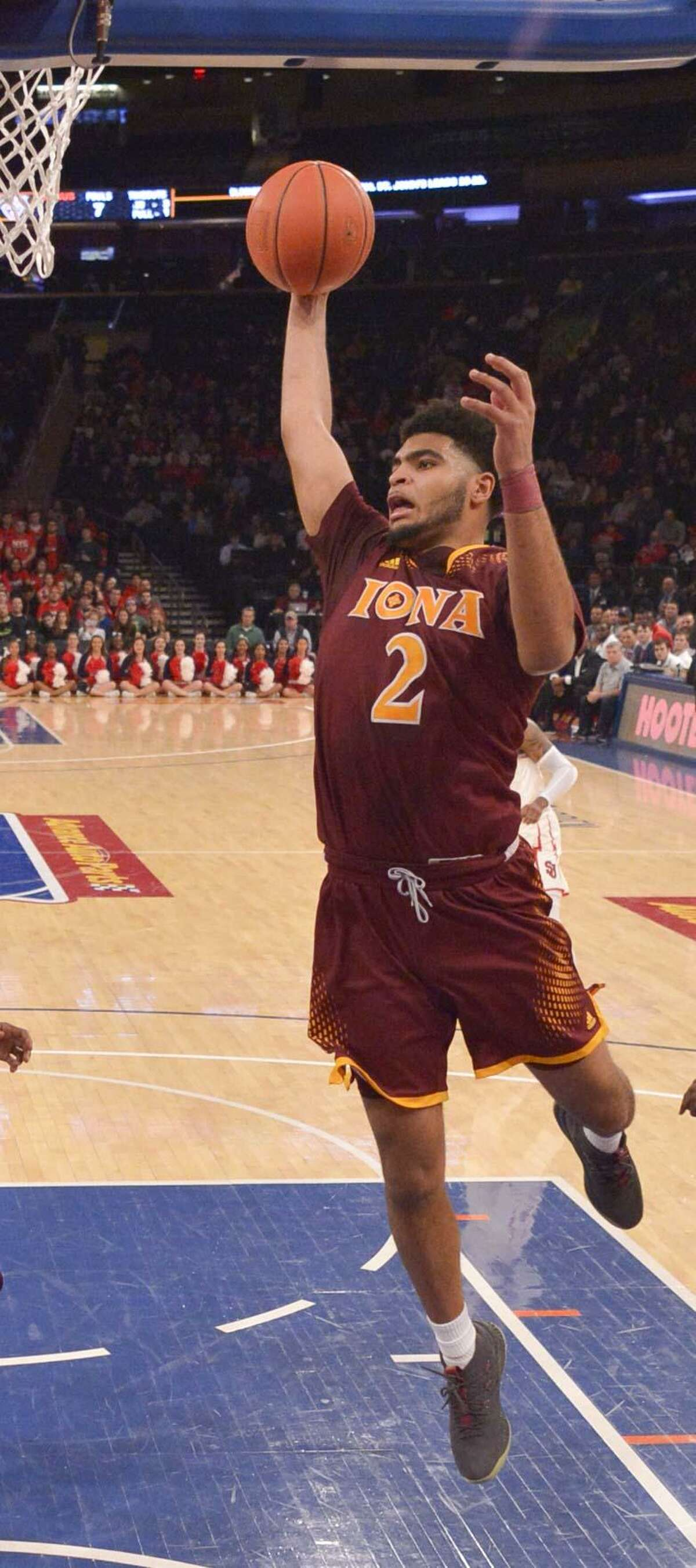 NEW YORK, NY - DECEMBER 17: E.J. Crawford #2 of the Iona Gaels rebounds against the St. John's Red Storm during the MSG Holiday Festival at Madison Square Garden on December 17, 2017 in New York City. (Photo by Porter Binks/Getty Images)