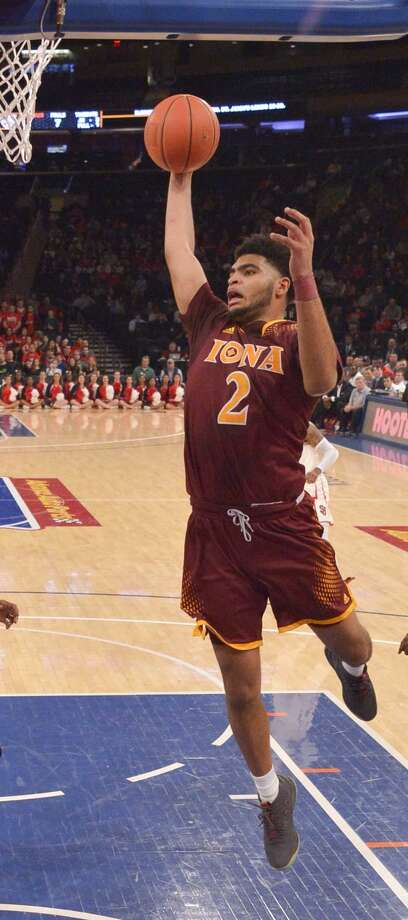 NEW YORK, NY - DECEMBER 17: E.J. Crawford #2 of the Iona Gaels rebounds against the St. John's Red Storm during the MSG Holiday Festival at Madison Square Garden on December 17, 2017 in New York City. (Photo by Porter Binks/Getty Images) Photo: Porter Binks / Getty Images / 2017 Porter Binks