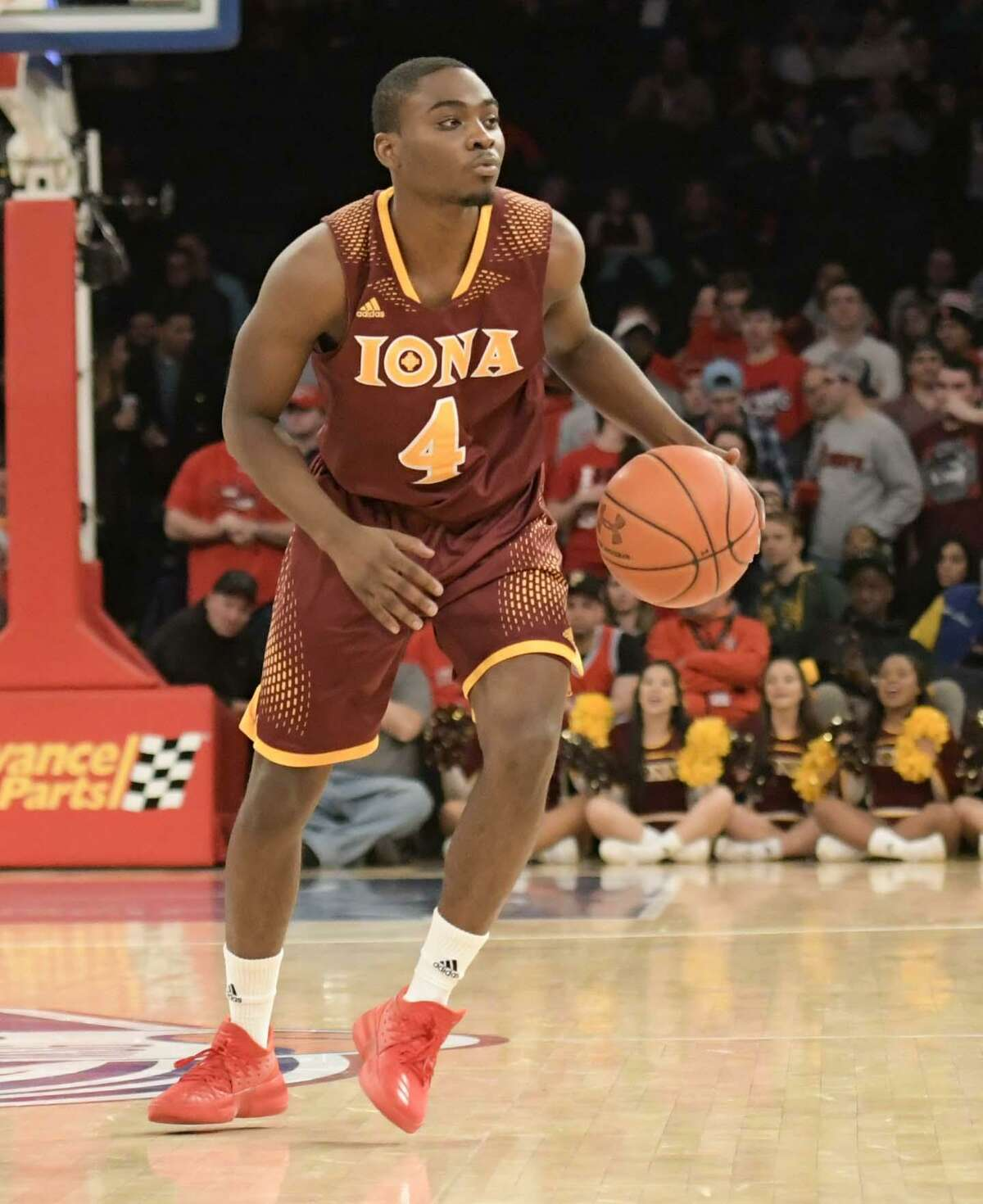 NEW YORK, NY - DECEMBER 17: Schadrac Casimir #4 of the Iona Gaels dribbles the ball against the St. John's Red Storm during the MSG Holiday Festival at Madison Square Garden on December 17, 2017 in New York City. (Photo by Porter Binks/Getty Images)