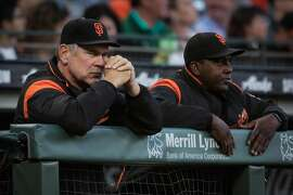 (l-r) Giants' manager Bruch Bochy (15) and hitting coach Hensley Meulens (31) watch the game between the San Francisco Giants and the Milwaukee Brewers at AT&T Park in San Francisco, Calif., on Tuesday, Aug. 22, 2017.