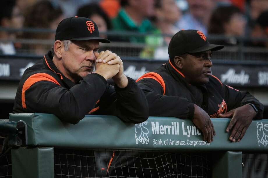 (l-r) Giants' manager Bruch Bochy (15) and hitting coach Hensley Meulens (31) watch the game between the San Francisco Giants and the Milwaukee Brewers at AT&T Park in San Francisco, Calif., on Tuesday, Aug. 22, 2017. Photo: Gabrielle Lurie / The Chronicle