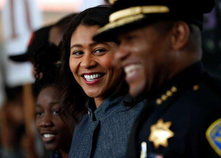 Acting Mayor London Breed and Police Chief William Scott enjoy marching on 3rd Street on Martin Luther King, Jr. Day  in San Francisco, Calif., on Monday, January 15, 2018.
