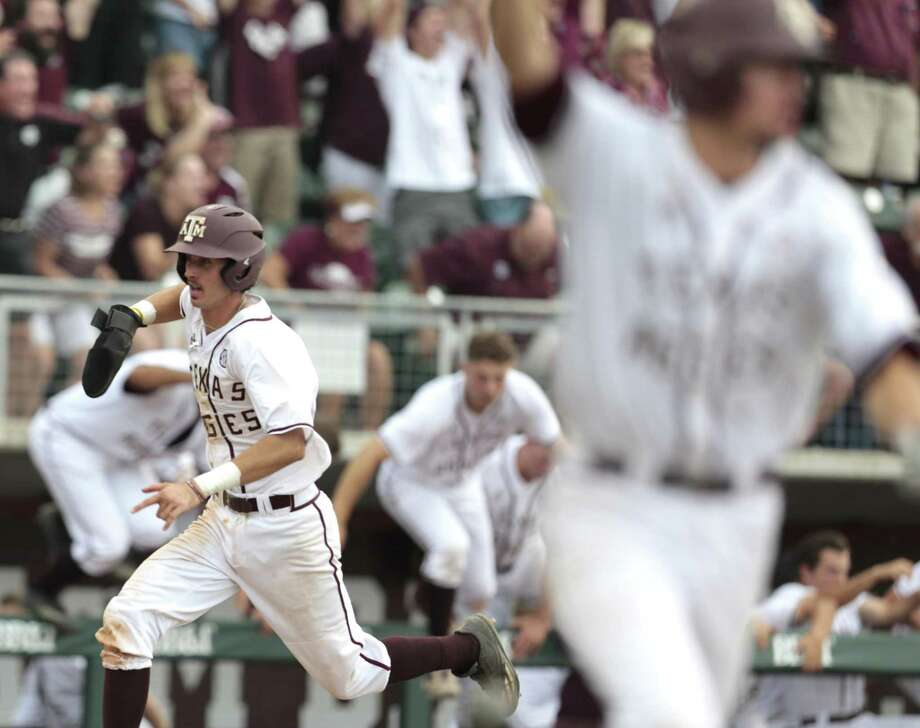 Texas A&M infielder Braden Shewmake (8) runs toward home as Texas A&M infielder George Janca (44) hit an RBI walk off single off Davidson pitcher Westin Whitmire to win 7-6 in 15 innings during the NCAA baseball Super Regional at Olsen Field at Blue Bell Park on Friday, June 9, 2017, in College Station. ( Brett Coomer / Houston Chronicle ) Photo: Brett Coomer, Staff / Houston Chronicle / HCN