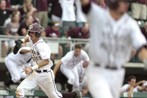 Texas A&M infielder Braden Shewmake (8) runs toward home as Texas A&M infielder George Janca (44) hit an RBI walk off single off Davidson pitcher Westin Whitmire to win 7-6 in 15 innings during the NCAA baseball Super Regional at Olsen Field at Blue Bell Park on Friday, June 9, 2017, in College Station. ( Brett Coomer / Houston Chronicle )