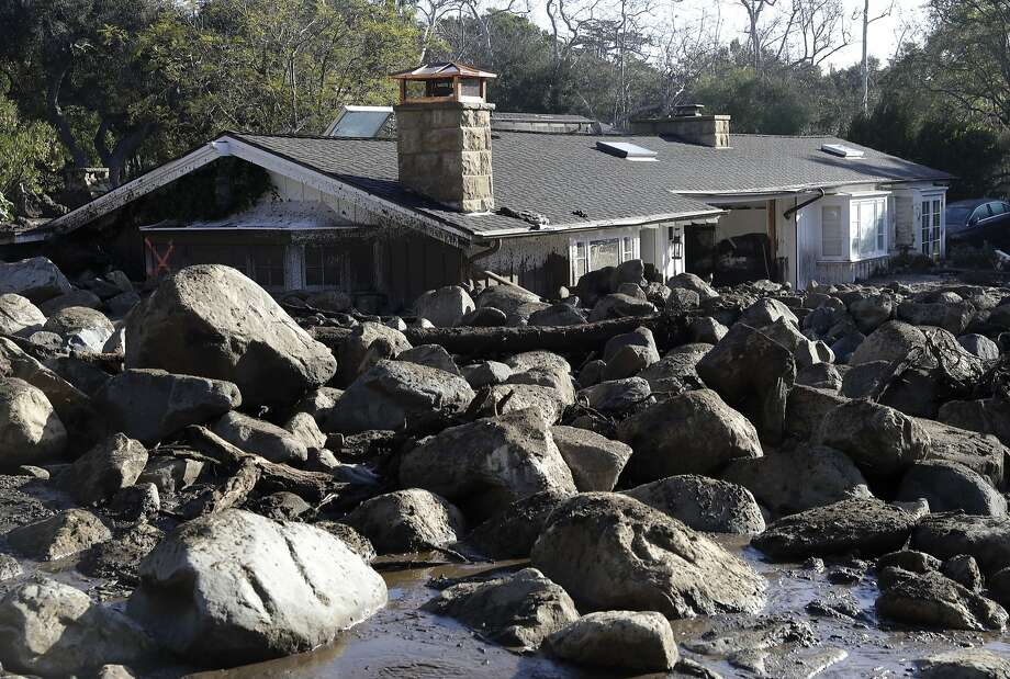 Rocks and mud flowed down slopes scoured bare by the Thomas Fire and into Montecito on Jan 9, destroying homes and killing at least 21 people. Photo: Marcio Jose Sanchez, Associated Press