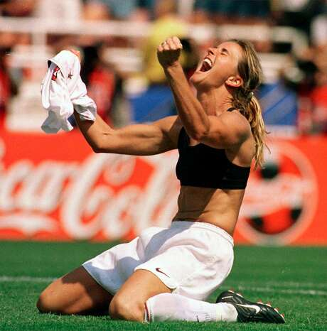 In this July 10, 1999, file photo, Brandi Chastain celebrates by taking off her jersey after kicking in the game-winning penalty shootout goal against China in the FIFA Women's World Cup Final at the Rose Bowl in Pasadena. Photo: Lacy Atkins, AP