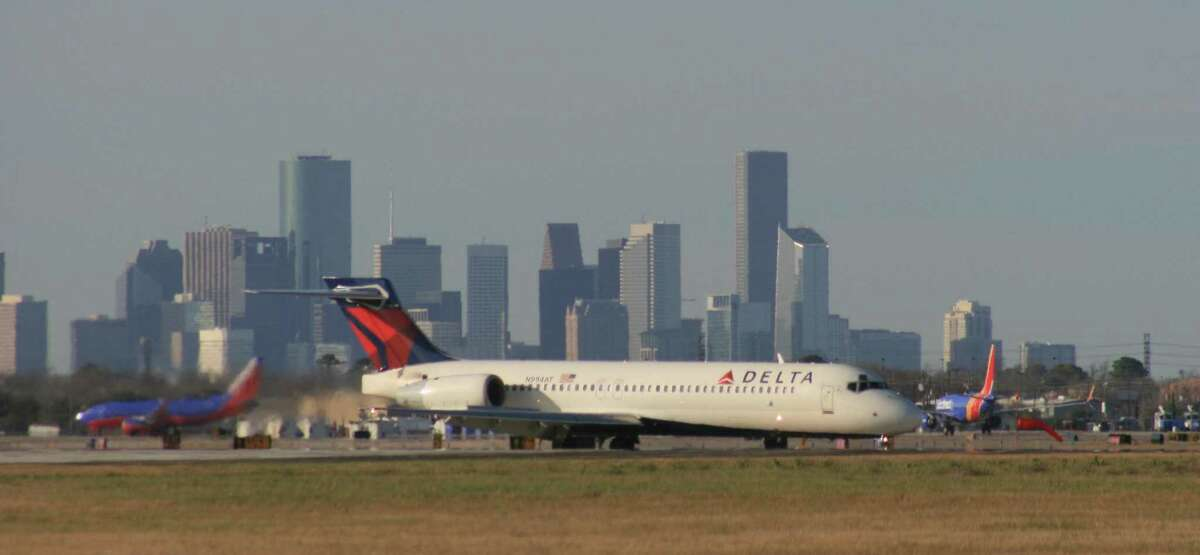 A Delta Air Lines Boeing 717 taxis after landing at Houston's Hobby Airport. Atlanta-based Delta pays out profit-sharing checks every year on Valentine's Day to its employees. This year, it amounts to an average bonus of about 10 percent of a Delta employee's annual pay. It's the fourth year in a row the company has paid out more than $1 billion in profit sharing.