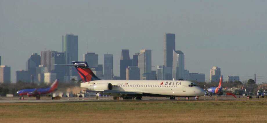A Delta Air Lines Boeing 717 taxis after landing at Houston's Hobby Airport. Atlanta-based Delta pays out profit-sharing checks every year on Valentine's Day to its employees. This year, it amounts to an average bonus of about 10 percent of a Delta employee's annual pay. It's the fourth year in a row the company has paid out more than $1 billion in profit sharing. Photo: Bill Montgomery /Houston Chronicle