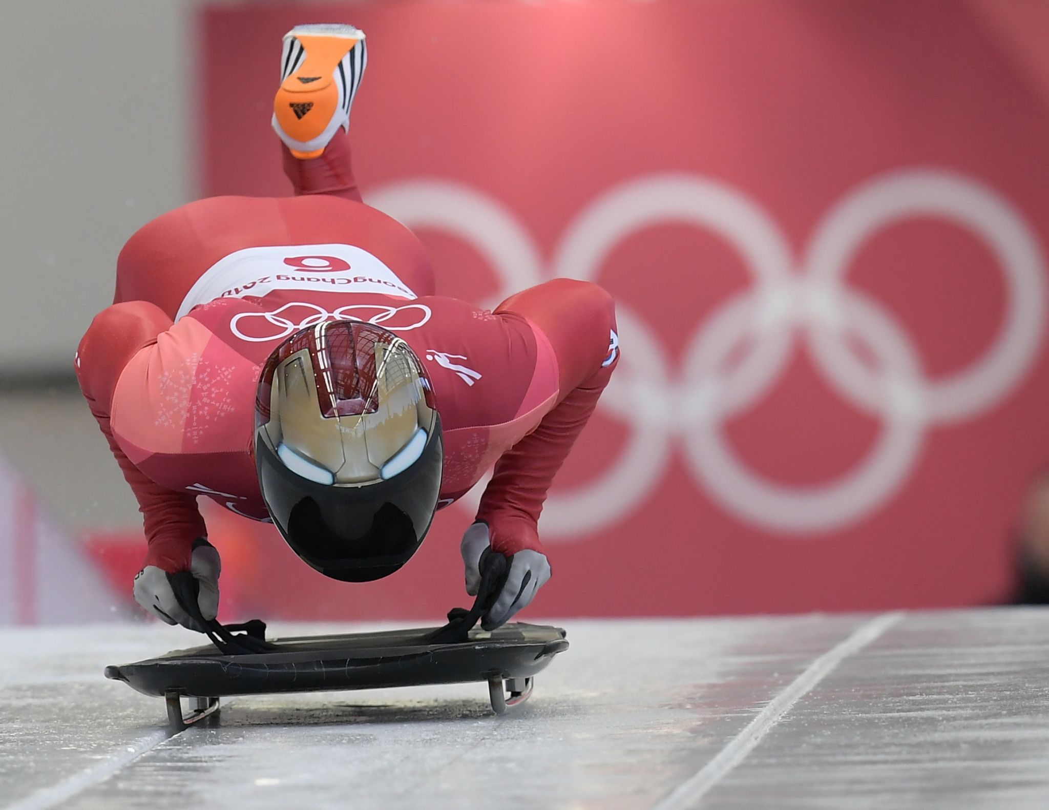 Skeleton athletes are wearing some very cool helmets
