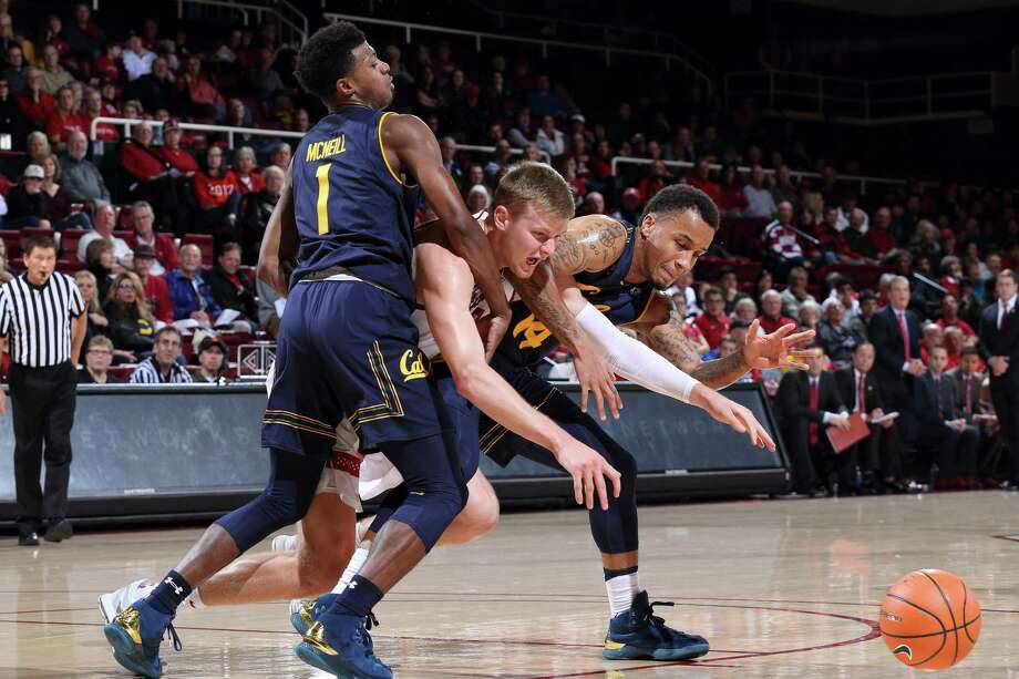 Stanford, CA - December 30, 2017:  Cal's Darius McNeill (#1) and Don Coleman (#14) hold off  Stanford's Michael Humphrey (#10) during NCAA Pac-12 Men's Basketball game at Maples Pavilion in Stanford, California. Photo: Bob Drebin / Bob Drebin / Isiphotos.com / Bob Drebin / isiphotos.com